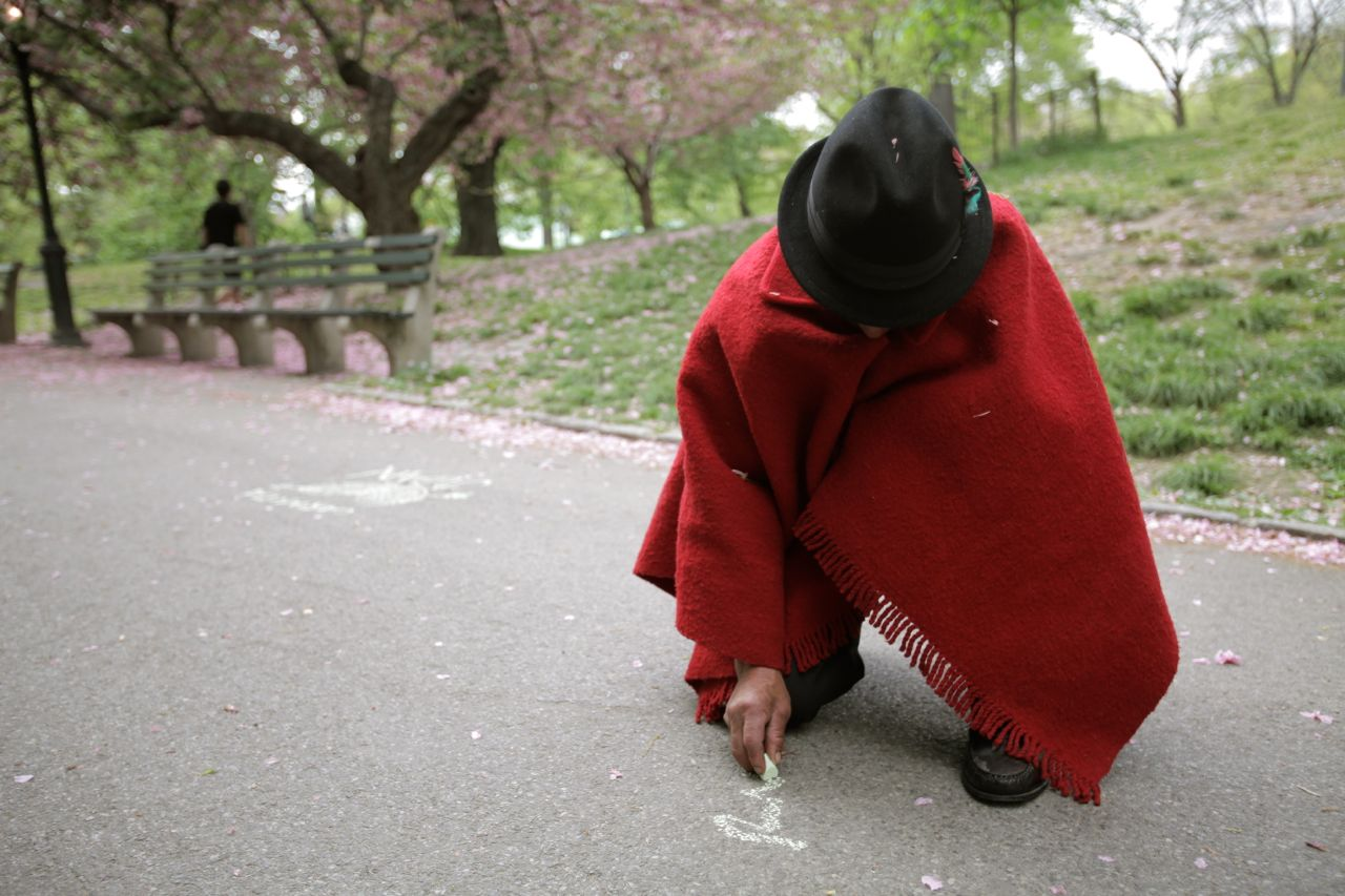 Baltazar draws with chalk in Central Park